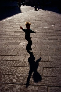 Boy Playing in Public Square.