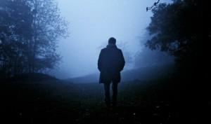 Man goes through the morning mist